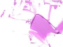 Smear purple make up liquid cream isolated on white background. Royalty Free Stock Photo