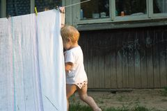 Smeared children play in nature in an improvised house. H stock photo