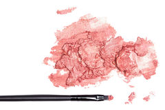 Smeared lipstick with makeup brush on white background Royalty Free Stock Image