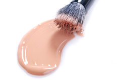 Smeared Liquid Beige Make Up Foundation on White Background Royalty Free Stock Images