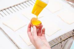 Smearing egg pie Royalty Free Stock Image