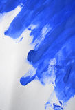 Smears of blue paint made by a finger. Swabs of blue paint made by a finger Royalty Free Stock Images