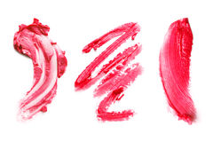 Smears lipstick on a white background Royalty Free Stock Photography