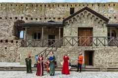 Artists dressed in medieval suits and playing music from the Middle Ages. royalty free stock photos