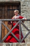 Woman from Europe with medievil clothes from the 14th century. Traditional europe costume. Smederevo, Serbia - May 02, 2019: The Smederevo Fortress is a stock images