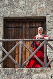 Woman from Europe with medievil clothes from the 14th century. Traditional europe costume. Smederevo, Serbia - May 02, 2019: The Smederevo Fortress is a royalty free stock photos