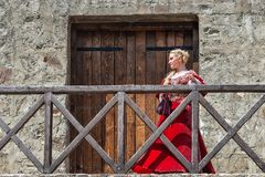 Woman from Europe with medievil clothes from the 14th century. Traditional europe costume. Smederevo, Serbia - May 02, 2019: The Smederevo Fortress is a stock photography