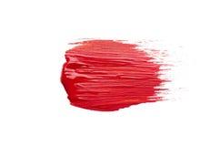 Smeer de rode borstel op witte achtergrond royalty-vrije stock afbeelding