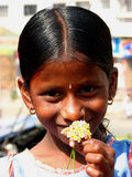 Smell the Flowers. An Indian girl smelling flowers Stock Photography