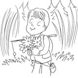 Smell flowers. Cute little boy smelling flowers Royalty Free Stock Photography