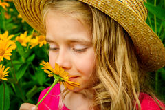 Smell the flowers Stock Images