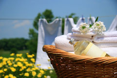 Smell of fresh towels. Wicker basket with laundry against a blue sky- late afternoon Stock Photography