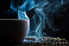 Smell of good tea from a small cup Royalty Free Stock Image