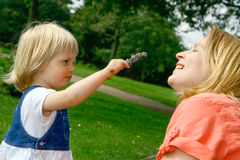 Smell the lavender, Mummy ! Royalty Free Stock Photos