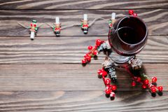 The smell of the new year, glass of wine and Christmas decoration. Christmas twig Royalty Free Stock Photo