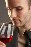 Smelling. Man taking a smell at a glass of red wine Stock Photos