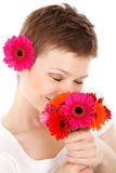 Smelling bouquet of flowers Royalty Free Stock Images
