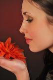 Smelling the flower. Closeup profile of a young woman smelling a flower Stock Images
