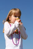 Smelling a flower. Little girl smelling a flower in the sunshine Royalty Free Stock Photos