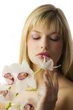 Smelling flower Stock Image