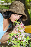 Smelling flowers Stock Images