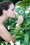 Smelling flowers Royalty Free Stock Image