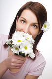 Smelling flowers Royalty Free Stock Photography