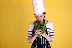 Smelling fresh herbs. Stock Photography