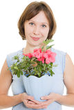 Smelling girl with flower. Stock Image