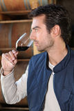 Smelling glass of red wine Stock Photos