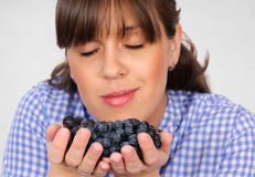 Smelling grapes Royalty Free Stock Image