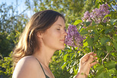 Smelling a lilac Stock Image