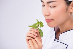 Smelling mint leaves Royalty Free Stock Photography