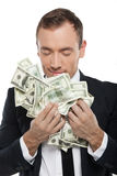 Smelling money. Royalty Free Stock Photos