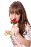 Smelling a rose. Stock Image