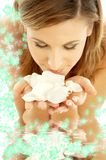 Smelling rose petals in water. Lovely woman in water smelling white rose petals royalty free stock photo