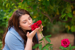 Smelling the roses Royalty Free Stock Images