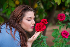 Smelling the roses Stock Photos