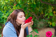 Smelling the roses Royalty Free Stock Photo