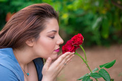 Smelling the roses Stock Image