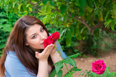 Smelling the roses Stock Images