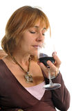 Smelling a wineglass Stock Images