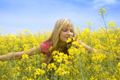 Smelling yellow flowers Royalty Free Stock Photo