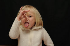 Smells bad. A cute blond girl making a face holding her nose - bad smell gesture stock photography