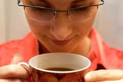 Smells good!. Secretary with nose piercing drinks hot coffee Stock Photography