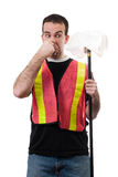 Smelly Garbage. Worker holding his nose because of the smell of old garbage, isolated against a white background Royalty Free Stock Image