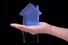 Smeltend ijzig huis Stock Afbeelding