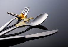 Smeltend vork, lepel en mes Stock Afbeeldingen