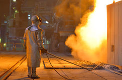 Smelting furnace and worker Royalty Free Stock Photography