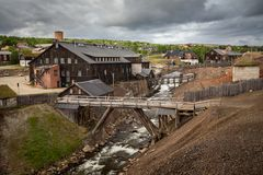 Smelting house and river Hyttelva in mining town Roros stock images